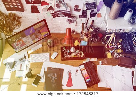 Fashion designer messy working table for sketching
