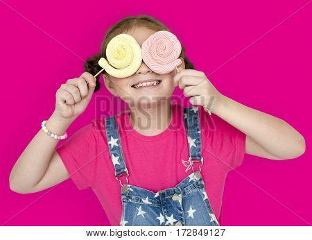 Little Girl Smiling Happiness Studio Portrait Sweet Lollipop