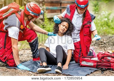 Rescue team helping injured victim, color image