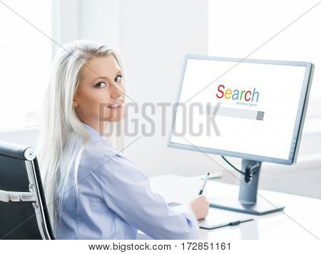 Young, attractive and confident woman working in office. Website, Internet, information, World Wide Web concept.