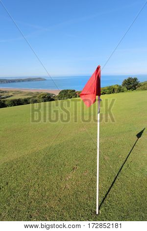 golf pin flag and home overlooking woolacombe beach in devon