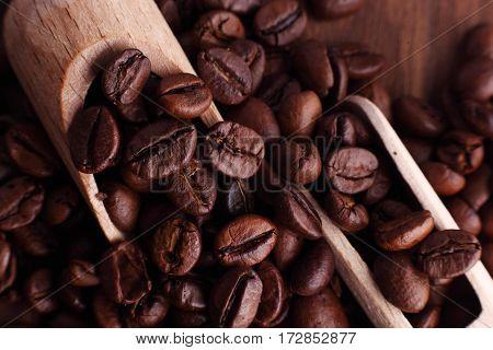 coffe in grains in wooden spoons aand