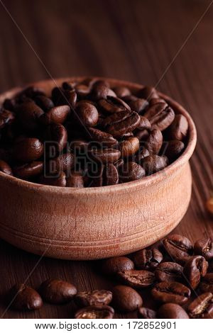 coffe in grains in wooden pkate and spoon