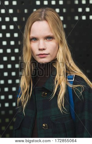 MILAN ITALY - FEBRUARY 22: Beautiful model poses outside Gucci fashion show building during Milan Women's Fashion Week on FEBRUARY 22 2017 in Milan.