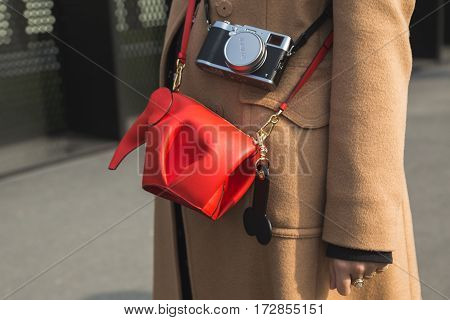 MILAN ITALY - FEBRUARY 22: Detail of bag outside Gucci fashion show building during Milan Women's Fashion Week on FEBRUARY 22 2017 in Milan.