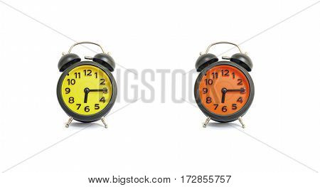 Closeup yellow alarm clock and orange alarm clock for decorate show a quarter past six or 6:15 a.m. isolated on white background