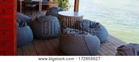 Interior of a summer terrace of restaurant where located near the sea that have the perfect Sea view.