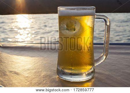 cold beer beverage at restaurant beside river in evening