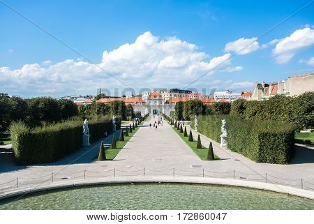 VIENNA AUSTRIA - JULY 29 2016: A view of palace Belvedere in Vienna (Austria) and its pond and garden on sunny summer day.