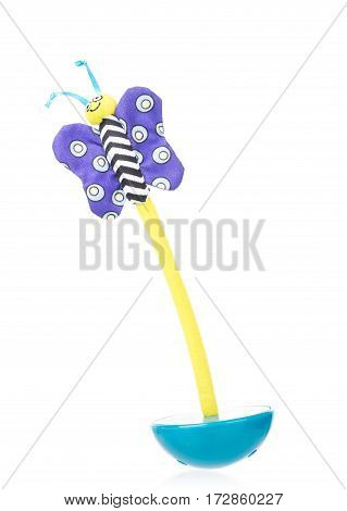 Bright tumbler toy with butterfly isolated over white background