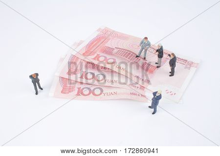 Mini Business Men On Bank Notes