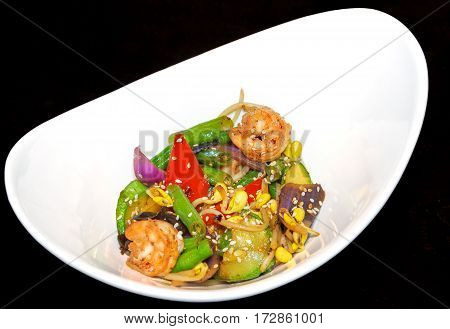 Tiger prawns vegetables Chinese mushrooms and beansprouts in oyster sauce. Dish with shrimps and vegetables. Asian food.