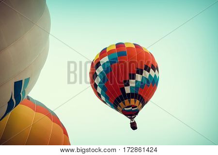 Colorful of Hot air balloons on blue sky - vintage retro filter effect color.