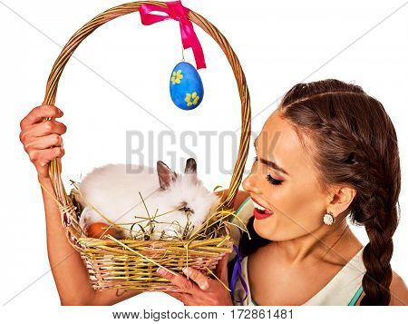 Easter woman holding bunny and decoration eggs. Holiday style holding and rabbits in basket with flowers. Adults at the festival. White rabbit and background.
