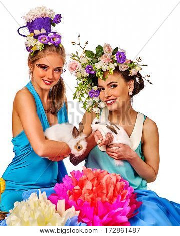 Easter girl together holding bunny. Women in holiday style celebrate take rabbits with flowers. Adults at the festival. Isolated.