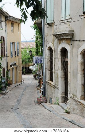 Tourists Shopping On A Small Alley Of Le Castellet