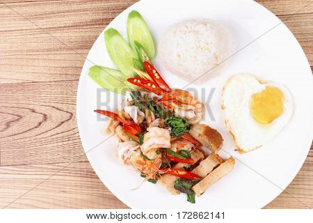 Jasmine Rice Topped Stir - Fried Spicy Basil With Meat.