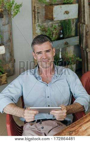 Man Connecting With His Tablet