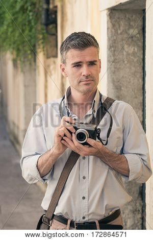 Photographer Exploring A City