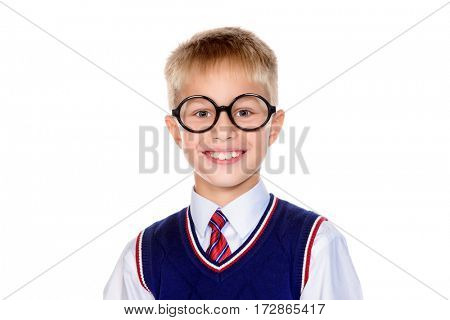 Smart school boy in glasses smiling at camera. Educational concept. Isolated over white background.