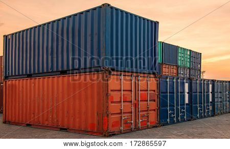 container ship in import export and business logistic.By crane Trade Port Shipping.Tugboat assisting cargo to harbor.