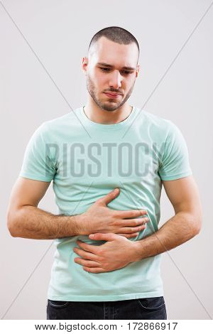 Young man is having pain in his stomach.
