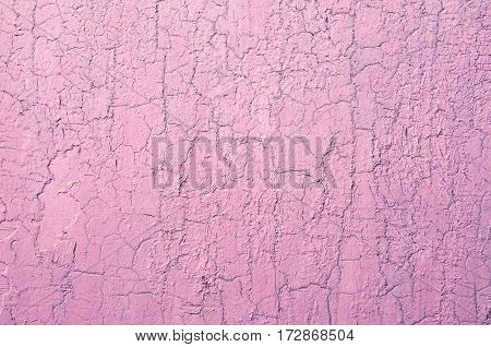 Old Damaged Cracked Paint Wall, Grunge Background, pink pastel color, horizontal