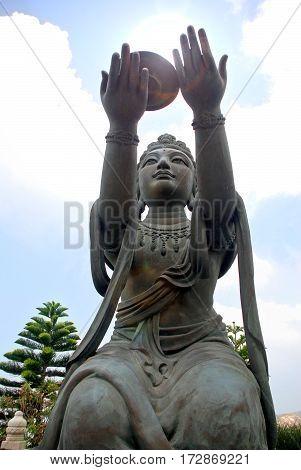 Statue Puja Bodhisattva at foot of Tian Tan giant Buddha Po Lin Monastery Ngong Ping La