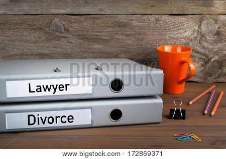 Divorce and Lawyer - two folders on wooden office desk.
