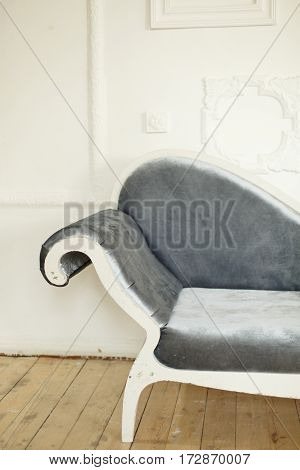 Vintage sofa on a background of a white brick wall