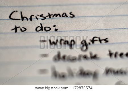Christmas to do list written on notebook for organization