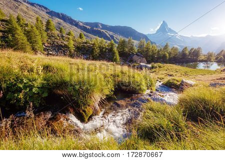 Scenic surroundings with famous peak Matterhorn in alpine valley. Dramatic and picturesque scene. Location place Swiss alps, Grindjisee, Valais region, Europe. Discover the world of beauty.