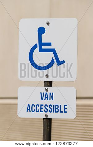 Handicap sign with van accessible at a parking lot