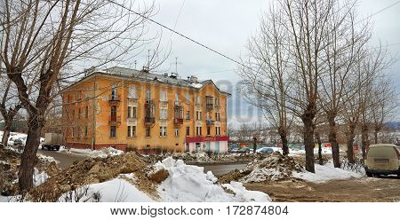NOVOURALSK/ RUSSIA - MARCH 8. Old Stalin-era building on Gorky Street in the city Novouralsk (closed town in Sverdlovsk Oblast Russia) on March 8, 2014.