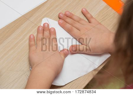 Girl Is Engaged In Origami, Make A Paper Airplane