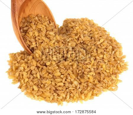 bulgur on a wooden spoon on a white background