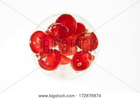 Glazed cherries with white back ground in glass