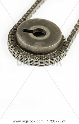 Oiled Cam Shaft With Timing Chain Isolated Over White Background