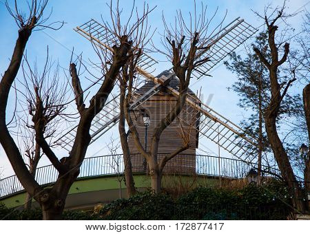 The windmill Radet on Montmartre hill built in 1717 Paris France. French landmarks and travel destination concept.