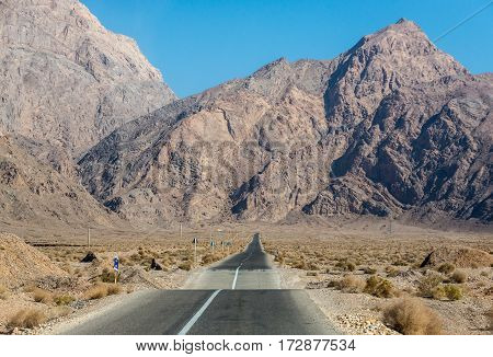 Road in rocky mountains area of Yazd Province in Iran