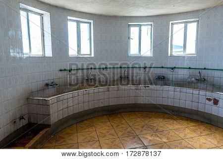 Sinks inside the public toilet in Iran