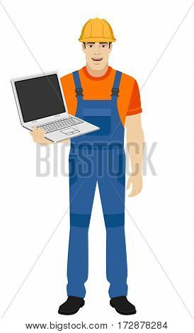 Builder with laptop. Full length portrait of builder in a flat style. Vector illustration.