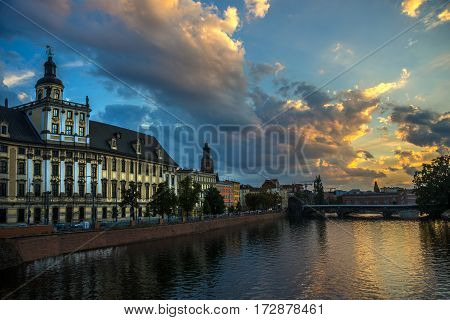 Wroclaw view: river Oder (or Odra) and University of Wroclaw against beautiful evening sky with clouds.