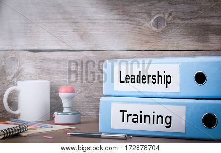 Training and Leadership. Two binders on desk in the office. Business background.