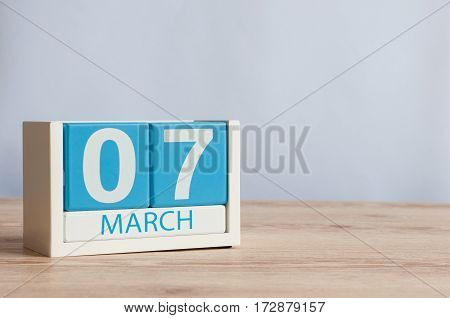 March 7th. Image of march 7 wooden color calendar on white background. Spring day, empty space for text.