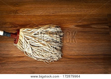 detail of mop cleaning on wood floor brown parquet