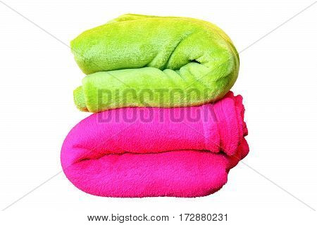 stack of colorful blankets pink and green isolated over white objects for your design