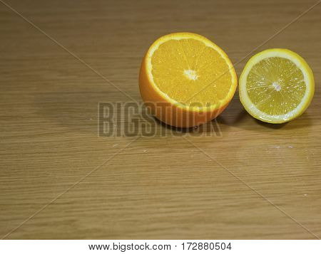 The orange and lemon on a isolated wooden surface