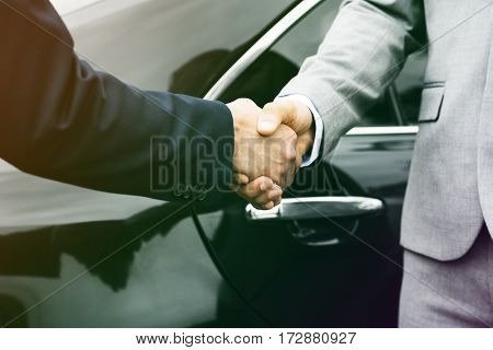 Businessmen greeting handshake deal with together