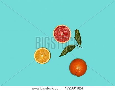 The group of fresh fruits against the blue background